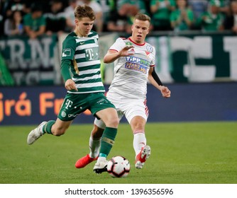 BUDAPEST, HUNGARY - MAY 11, 2019: (l-r) Andras Csonka competes for the ball with Attila Haris during Ferencvarosi TC v DVSC OTP Bank Liga match at Groupama Arena.