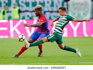 BUDAPEST, HUNGARY - MAY 12, 2018: (l-r) Manjrekar James competes for the ball with Dominik Nagy during Ferencvarosi TC v Vasas FC match at Groupama Arena.
