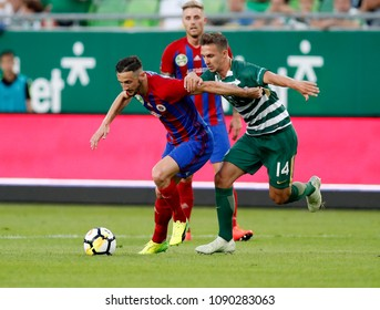 BUDAPEST, HUNGARY - MAY 12, 2018: Dominik Nagy #14 fights for the ball with Kire Ristevski (l) in front of Felix Burmeister (l2) during Ferencvarosi TC v Vasas FC match at Groupama Arena.