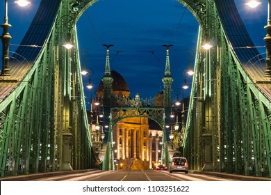 Budapest, Hungary - may 12, 2018: Cars and tram on a Liberty bridge (Szabadsag hid) at night  in  Budapest,Hungary.