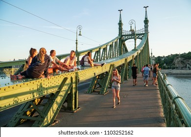 Budapest, Hungary - may 13, 2018: People relax and walk on a  Liberty bridge (Szabadsag hid) in  Budapest,Hungary.