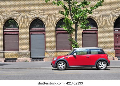 BUDAPEST, HUNGARY - MAY 16: Mini Cooper parked in the street  of Budapest on May 16, 2016. Mini Cooper is a British automotive marque owned by BMW.