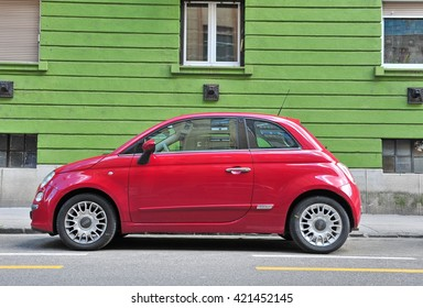 BUDAPEST, HUNGARY - MAY 16: Red new Fiat 500 in the street of Budapest on May 16, 2016. Fiat 500 is a passenger car manufactured by Fiat since 2007.