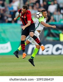BUDAPEST, HUNGARY - MAY 19, 2018: (l-r) Marton Eppel battles for the ball in the air with Leandro De Almeida 'Leo' during Budapest Honved v Ferencvarosi TC match at Bozsik Stadium.