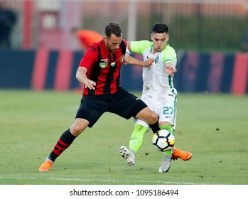 BUDAPEST, HUNGARY - MAY 19, 2018: (l-r) Marton Eppel competes for the ball with Fernando Gorriaran during Budapest Honved v Ferencvarosi TC match at Bozsik Stadium.