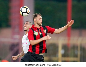 BUDAPEST, HUNGARY - MAY 19, 2018: (l-r) Leandro De Almeida 'Leo' battles for the ball in the air with Marton Eppel during Budapest Honved v Ferencvarosi TC match at Bozsik Stadium.