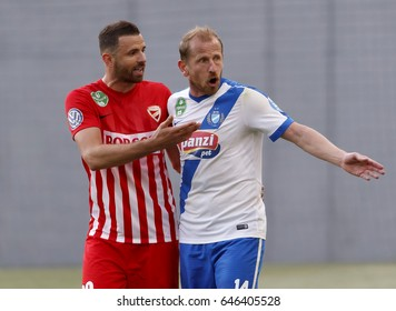 BUDAPEST, HUNGARY - MAY 20, 2017: Sandor Torghelle (R) of MTK Budapest argues with Attila Busai (L) of DVTK about a foul during MTK Budapest v DVTK  match at Nandor Hidegkuti Stadium.