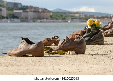 Budapest, Hungary - May 20, 2019 :  Gyula Pauer sculture Shoes on the Danube memorial to Jewish victims of the Arrow Cross during WWII on the Pest side of the Danube River in Budapest, Hungary.