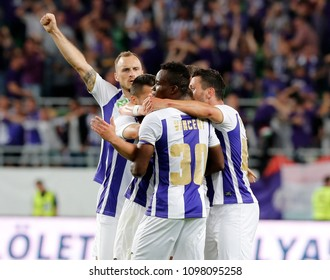 BUDAPEST, HUNGARY - MAY 23, 2018: (l-r) Robert Litauszki celebrates a goal with Vincent Onovo #30 and Branko Pauljevic (r) during Puskas Akademia FC and Ujpest FC match at Groupama Arena.