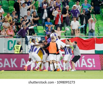 BUDAPEST, HUNGARY - MAY 23, 2018: Unidentified teammates celebrate goalkeeper Filip Pajovic (l3) after he saved the last penalty during Puskas Akademia FC and Ujpest FC match at Groupama Arena.