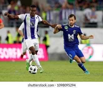 BUDAPEST, HUNGARY - MAY 23, 2018: (l-r) Vincent Onovo wins the ball from David Markvart during Puskas Akademia FC and Ujpest FC match at Groupama Arena.