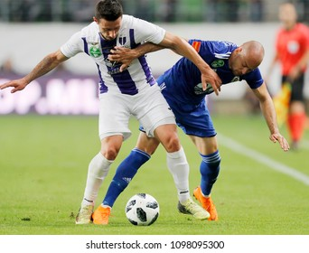 BUDAPEST, HUNGARY - MAY 23, 2018: (l-r) Branko Pauljevic competes for the ball with Peter Szakaly during Puskas Akademia FC and Ujpest FC match at Groupama Arena.