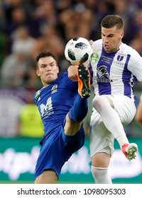 BUDAPEST, HUNGARY - MAY 23, 2018: (l-r) Antonio Perosevic competes for the ball with Dzenan Burekovic during Puskas Akademia FC and Ujpest FC match at Groupama Arena.