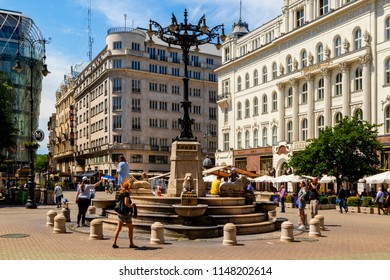 Budapest, Hungary - May 23 2018: Tourists and visitors on the famous Vorosmarty Plaza - center of Down Town -, one of the main shopping area in Budapest.