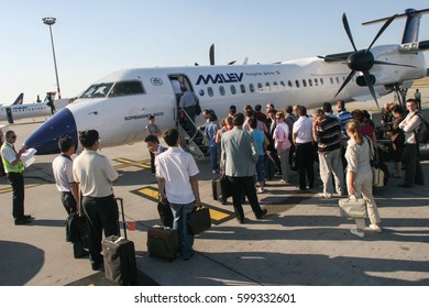 Budapest, Hungary, May 24, 2009: People are waiting to board to the plane on the Budapest Ferenc Liszt International Airport.