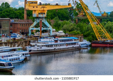 Budapest Hungary May 24 2018: Old shipyard and boat dismounting dock. Vintage river cruisers and pleasure craft are maintained and dismounted here.
