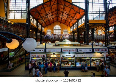 Budapest Hungary - May 24, 2018: People shopping in the Grand Market Hall. Great Market Hall is the largest indoor market in Budapest, it was built in 1896 still in full glory.