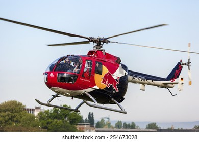 BUDAPEST HUNGARY - MAY 3: A Red Bull aerobatic helicopter   demonstrate different flying techniques, for civilian as well as some air force personnel on May 1 2014 Hungary.
