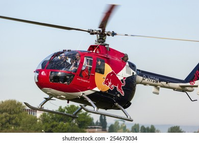 BUDAPEST HUNGARY - MAY 3: A Red Bull aerobatic helicopter demonstrates different flying techniques, for civilian as well as some air force personnel on May 1 2014 Hungary.