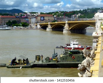 Budapest, Hungary - May 31, 2019: The Salvage operations on the Danube under Margaret Bridge, the location and scene of the May 29th boat accident. Military boat and fire rescue boat in operation.
