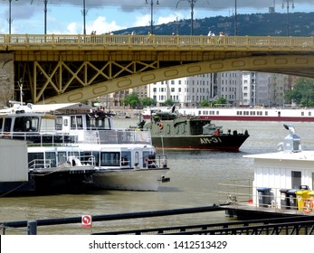 Budapest, Hungary - May 31, 2019: The Salvage operations on the Danube under Margaret Bridge, the location and scene of the May 29th boat accident. Military boat and other rescue boats in operation