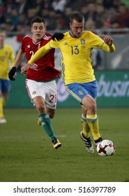 BUDAPEST, HUNGARY - NOVEMBER 15, 2016: Zsombor Berecz #21 of Hungary tries to pull back Jakob Johansson #13 of Sweden during the Hungary v Sweden friendly game at Groupama Arena.