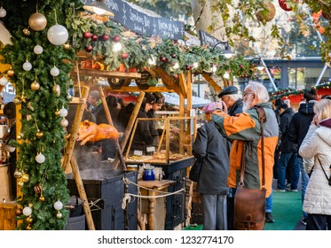 BUDAPEST, HUNGARY - NOVEMBER  17, 2018: People visit Annual Christmas Fair on Vorosmarty square in Budapest, Hungary.