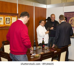 BUDAPEST, HUNGARY - NOVEMBER 19: Lajos Biro (l) star chef, anchor, owner of Bock Bistro visits the 1st Taste and Wine Exposition - Hungexpo on November 19, 2011 in Budapest, Hungary.