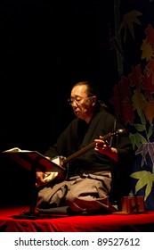 BUDAPEST, HUNGARY - NOVEMBER 22: Sekkyo Masadau, member of the japan Minwa Group plays on the Utsushi-e (Slide Show) presentation in the Merlin Theater on November 22, 2011 in Budapest, Hungary.
