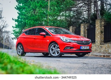 BUDAPEST, HUNGARY - NOVEMBER 27, 2015: 2016 model year Opel Astra (generation K) is on display. Red hatchback Opel Astra is equipped with headlights that consist of 16 individual matrix LED.