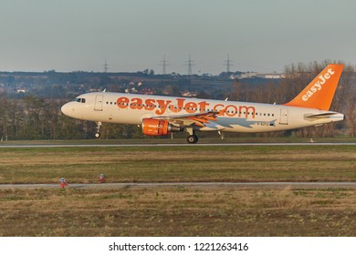 BUDAPEST, HUNGARY - NOVEMBER 5, 2014: EasyJet A320 touching ground at Budapest Liszt Ferenc Airport. Easyjet is the second largest low-cost airline of Europe.