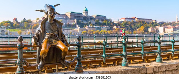 Budapest, Hungary - November 5, 2014: Icon of Budapest city Princess Jester statue against Buda panoramic skyline
