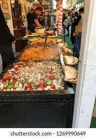 Budapest, Hungary - November 9, 2018: Christmas Market and Winter Festival at Vorösmarty Square - Hungarian traditional langos being prepared