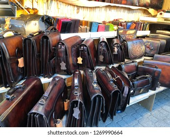 Budapest, Hungary - November 9, 2018: Christmas Market and Winter Festival at Vorösmarty Square - Leather briefcases and other stems on a market stall