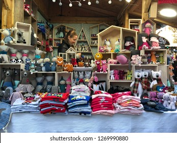 Budapest, Hungary - November 9, 2018: Christmas Market and Winter Festival at Vorösmarty Square -Hand knitted children's stuffed animals and other children's clothing