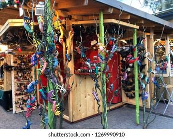 Budapest, Hungary - November 9, 2018: Christmas Market and Winter Festival at Vorösmarty Square - A market stall with hand crafted iguanas, lizards and frogs
