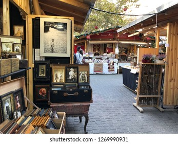 Budapest, Hungary - November 9, 2018: Christmas Market and Winter Festival at Vorösmarty Square - A market stall with photographs and picture frames