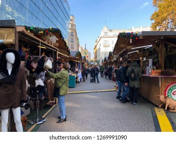 Budapest, Hungary - November 9, 2018: Tourists shopping at the Christmas Market and Winter Festival at Vörösmarty Square