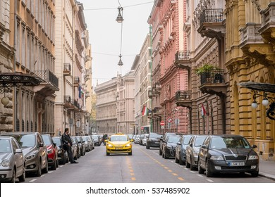 Budapest, Hungary - Oct 2016: Man Leaning Against Parked Car on the Street of Budapest City