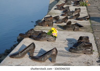 Budapest, Hungary - Oct 8, 2010:   Holocaust Memorial with shoes near the Danube promenade for the jews killed by nazis