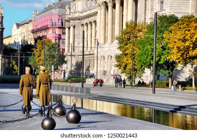 BUDAPEST, HUNGARY - OCTOBER 07, 2016: Hungarian National Guard in front of the Hungarian Parliament. Two Hungarian Soldiers in sunglasses, caps, uniforms and high black boots marching