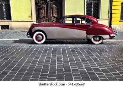 BUDAPEST, HUNGARY - OCTOBER 08, 2016: Vintage car parked on the old street in Budapest