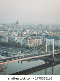 BUDAPEST, HUNGARY - OCTOBER, 2019: Mourning view of Budapest city and Elizabeth bridge with reflection in Danube river