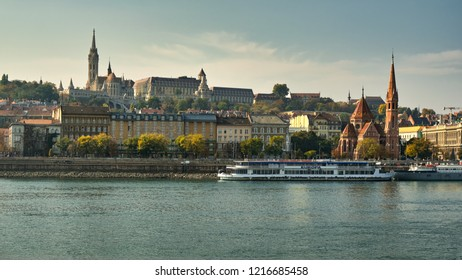 Budapest / Hungary - October 20th 2018: Buda Castle District of Budapest with Matthias Church and Fisherman's Bastion dominating the skyline over Danube river.