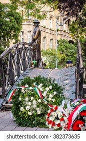 BUDAPEST, HUNGARY - October 25, 2014: Flowers and wreaths near a statue of Imre Nagy to commemorate the October 23rd Hungarian National Holiday.