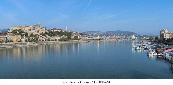 BUDAPEST, HUNGARY - OCTOBER 3, 2015: Panoramic view on Danube from Elisabeth Bridge. The main landmarks on the image are: Royal Palace, Matthias Church, Fisherman's Bastion and Szechenyi Chain Bridge.