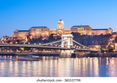 BUDAPEST, HUNGARY - OCTOBER 30, 2015: Chain bridge, Danube and Royal Palace in Budapest, Hungary. Evening photo shoot. Did it with tripod. Blurry Ferry in water.