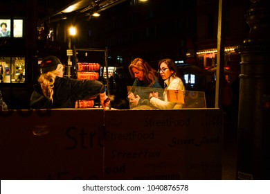 Budapest, Hungary - October 6, 2017: People buying fast food on the street of European city. Street food concept