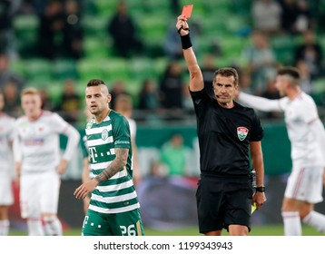 BUDAPEST, HUNGARY - OCTOBER 6, 2018: (r-l) Referee Zoltan Ivanyi shows the red card for Marcel Heister during Ferencvarosi TC v DVSC match at Groupama Arena.