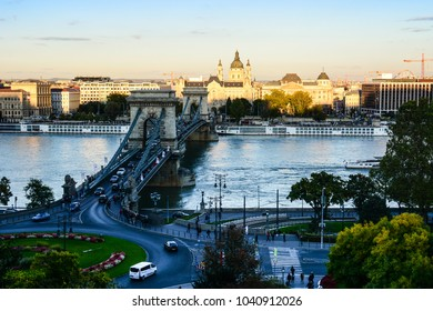 Budapest, Hungary - October 7, 2017: Cityscape of Budapest with St. Stephen's Basilica, Danube river, Szechenyi Chain Bridge and lot of cars moving there